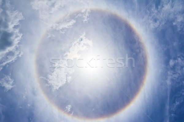 Corona on blue sky, ring around the sun Stock photo © tungphoto