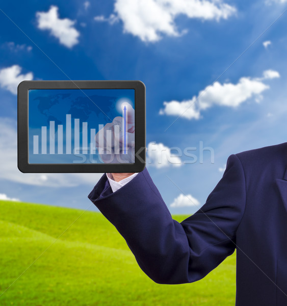 hand pointing higher graph on tablet PC Stock photo © tungphoto