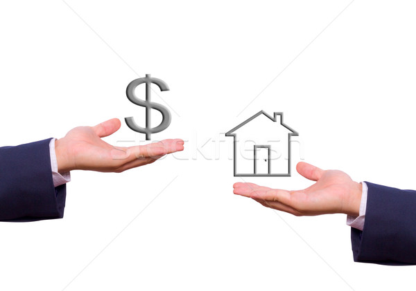 Stock photo: business man hand exchange dollar sign and house icon