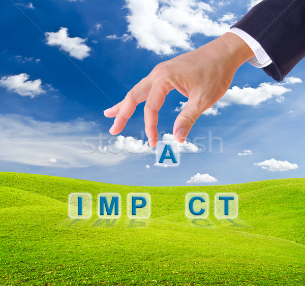 business man hand made impact word buttons Stock photo © tungphoto