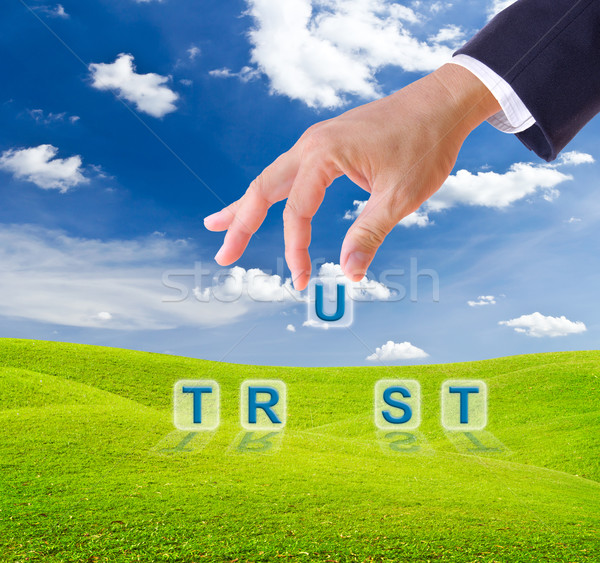 business man hand made trust word buttons Stock photo © tungphoto