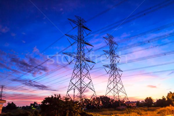 electricity high voltage power pylon at dusk Stock photo © tungphoto