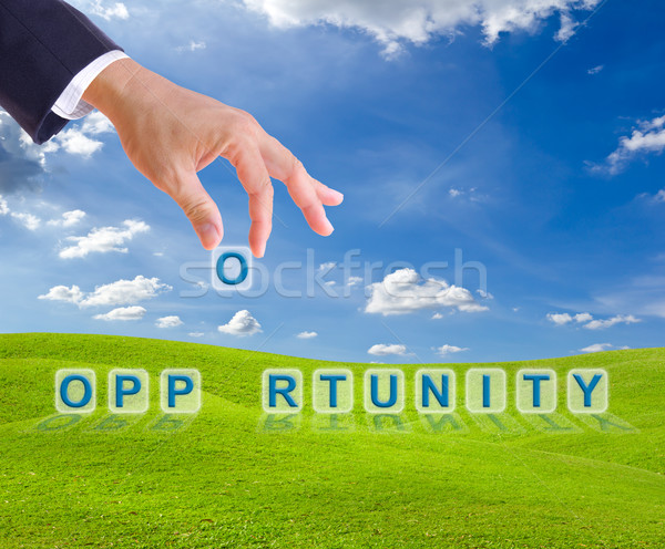business man hand made opportunity word buttons Stock photo © tungphoto