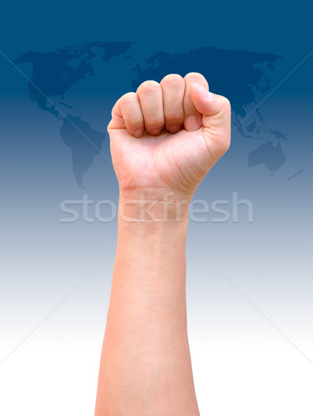 fist hand on world map background Stock photo © tungphoto