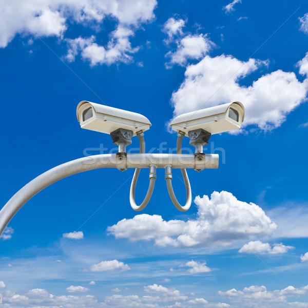 surveillance cameras against blue sky Stock photo © tungphoto