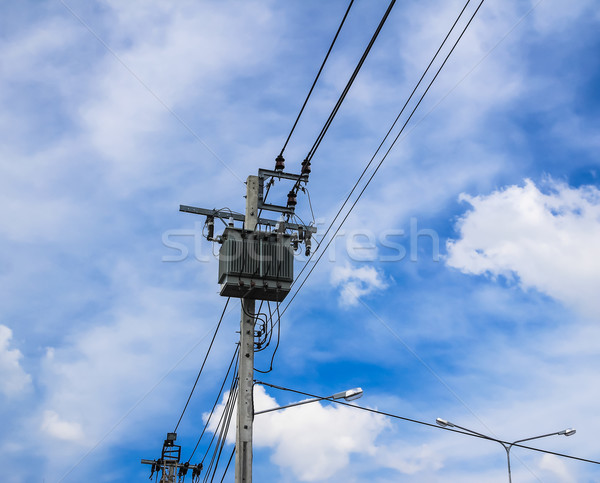 electricity high voltage transformer against blue sky Stock photo © tungphoto