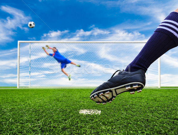 foot shooting soccer ball out of goal Stock photo © tungphoto