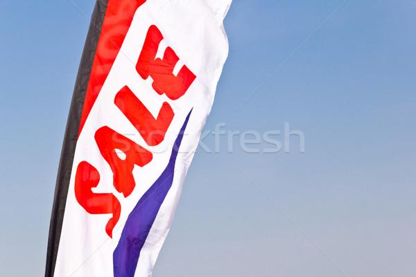sale flag flying against blue sky Stock photo © tungphoto