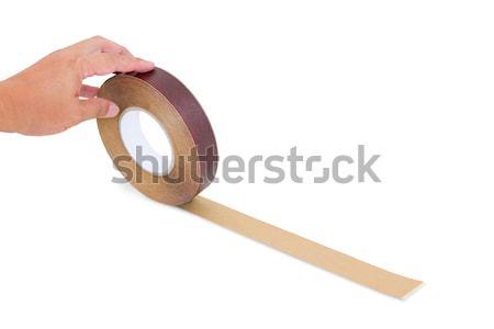 Kéz tart fa szalag izolált vágási körvonal Stock fotó © tungphoto