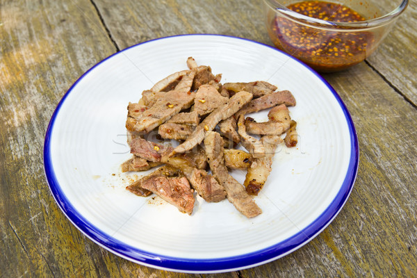 fired meat with chili sauce Stock photo © tungphoto