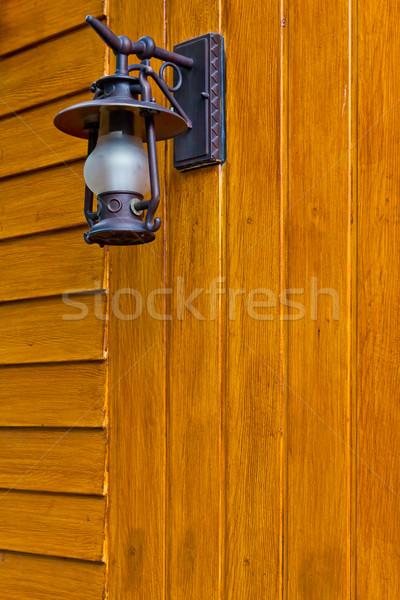 vintage lantern on wood wall Stock photo © tungphoto