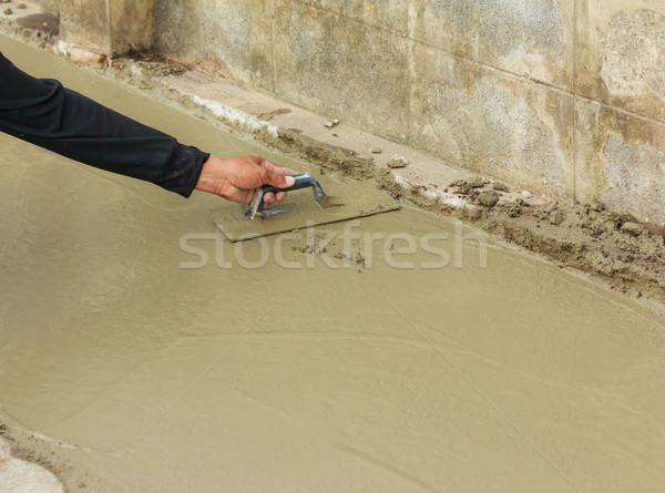 hand pastering cement mortal on the floor Stock photo © tungphoto