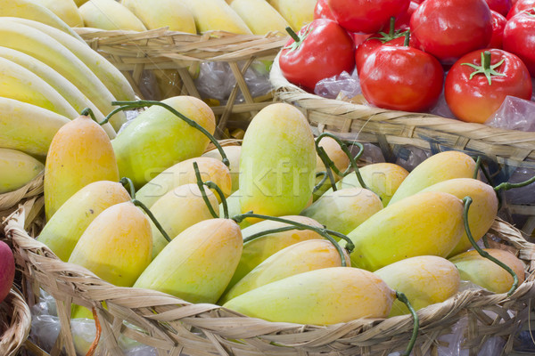 yellow mango in bamboo basket Stock photo © tungphoto