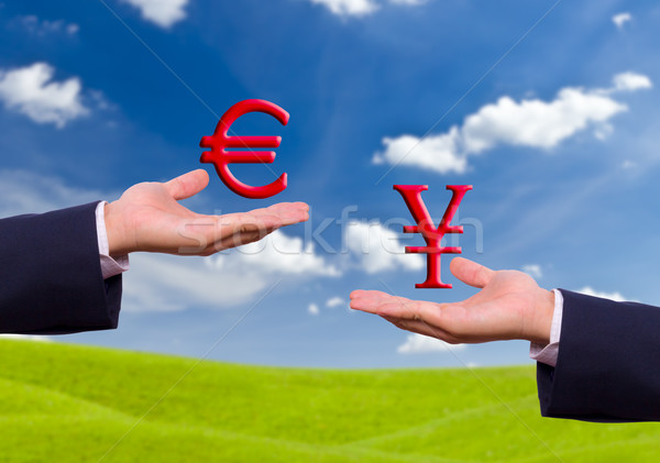 hand exchange euro and yen sign Stock photo © tungphoto