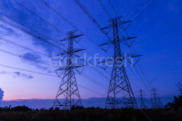 electricity high voltage power post at twilight evening Stock photo © tungphoto
