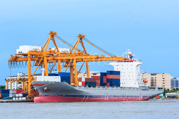 crane working with container cargo in shipyard Stock photo © tungphoto