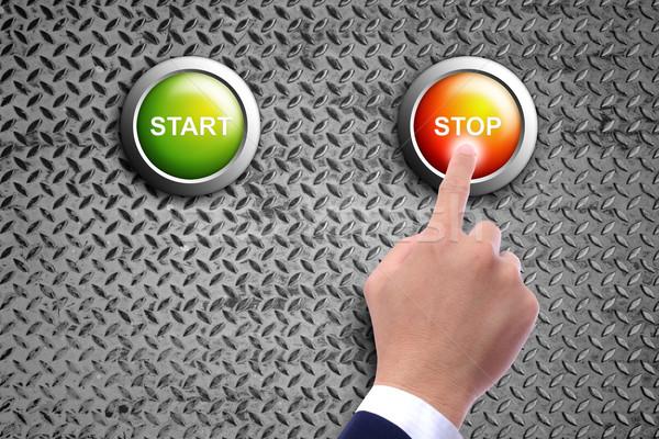 hand pushing stop button on diamond steel background Stock photo © tungphoto