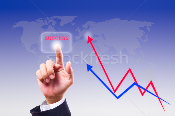 hand pushing success button and graph Stock photo © tungphoto