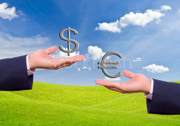 Zakenman hand uitwisseling dollar euro teken Stockfoto © tungphoto