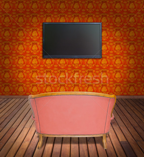 television and sofa in orange wallpaper room Stock photo © tungphoto