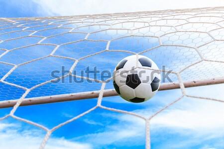 футбольным мячом цель чистой спорт футбола лет Сток-фото © tungphoto