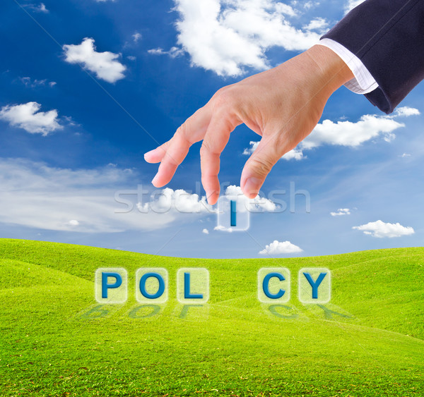 business man hand made policy word buttons Stock photo © tungphoto