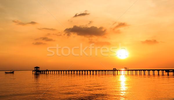 シルエット 人 木材 橋 日没 水 ストックフォト © tungphoto