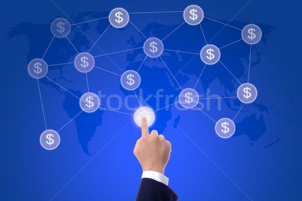 Homem de negócios mão botão dinheiro rede Foto stock © tungphoto