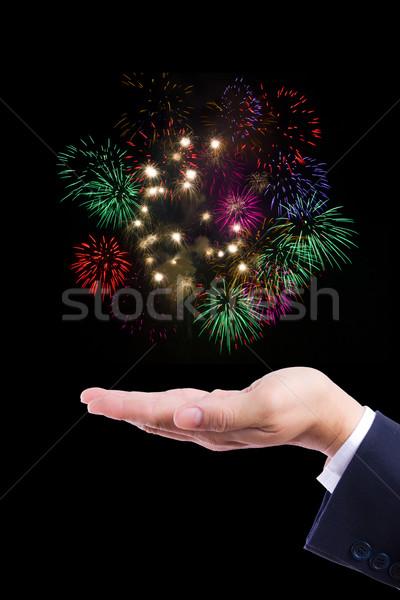 firework on hand Stock photo © tungphoto