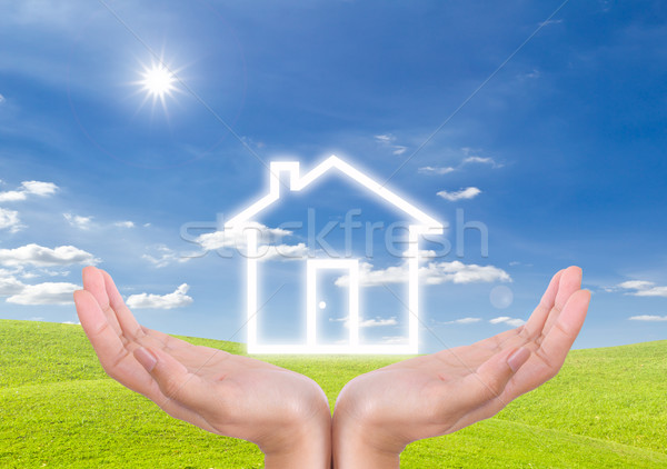 House icon on hand Stock photo © tungphoto