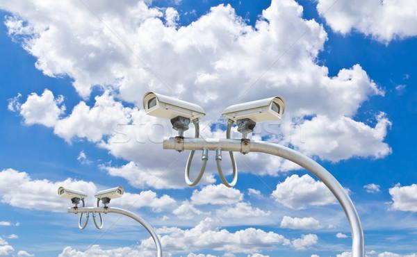 Szabadtér cctv fényképezőgépek kék ég biztonság égbolt Stock fotó © tungphoto