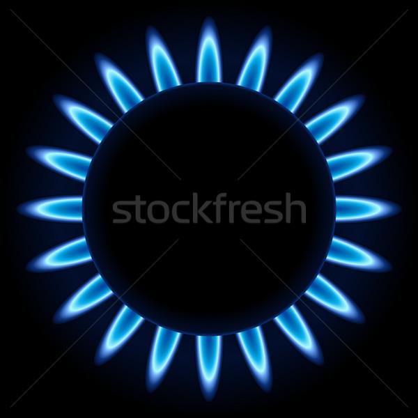 Blue flames ring of kitchen gas burner isolated on black backgro Stock photo © tuulijumala