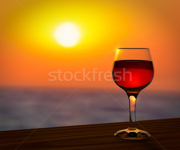 Red wine glass at the summer sunset romantic background. Stock photo © tuulijumala
