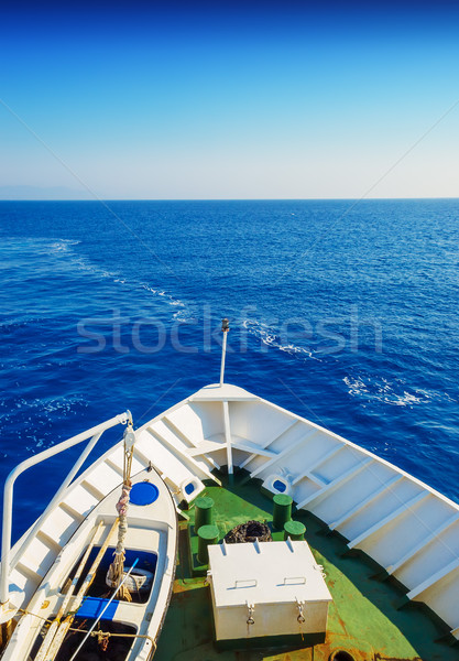 Snout of the sailing ship in the open blue sea in sunny day. Stock photo © tuulijumala
