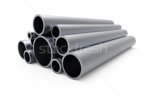 Pile of steel pipes isolated on white background. Stock photo © tuulijumala
