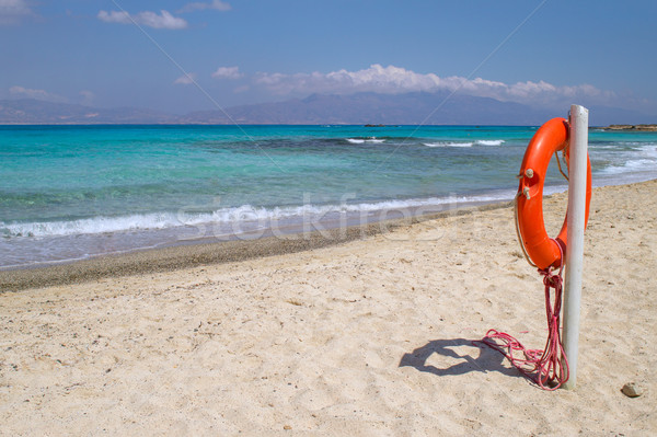 Chrisi island white beach with red  life buoy in foreground, Cre Stock photo © tuulijumala