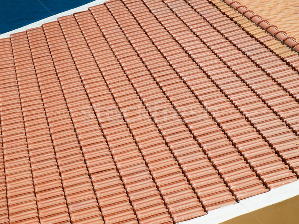 Newly laid clay tiled roof. Stock photo © tuulijumala