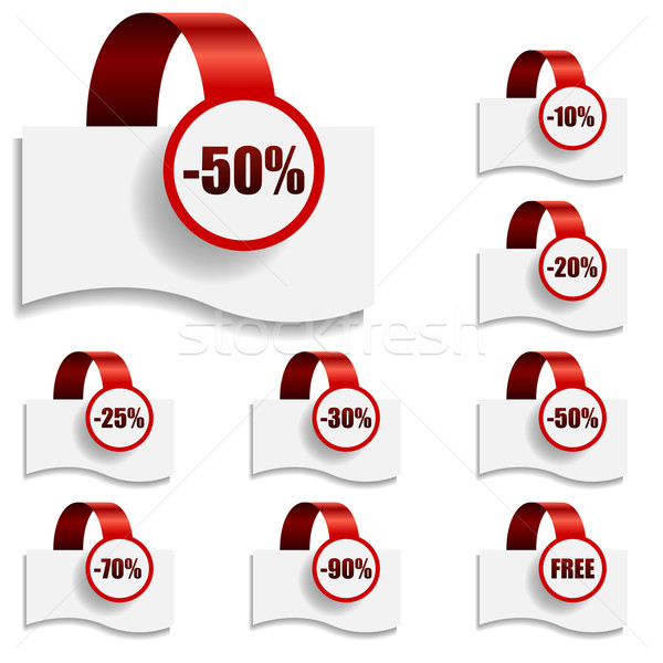 Discount tags on bent red ribbon.  Stock photo © tuulijumala