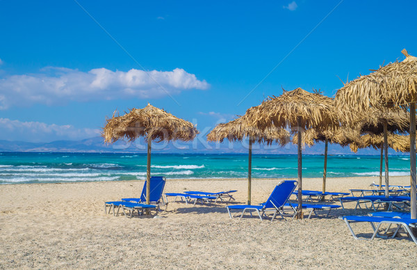 Chrisi (Chrysi) island beach background with straw sunshades, Cr Stock photo © tuulijumala