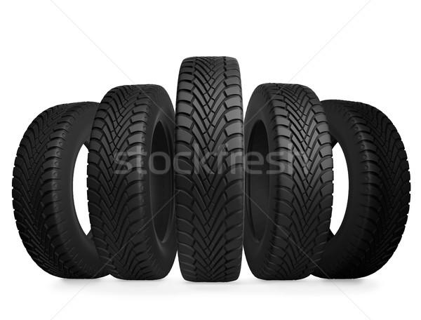 Five automobile tires isolated on white background. Stock photo © tuulijumala
