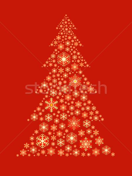 Christmas tree shape made of golden snowflakes on red background Stock photo © tuulijumala