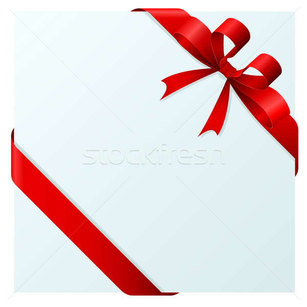 Red bow and ribbon wrapping paper sheet at the corners isolated  Stock photo © tuulijumala