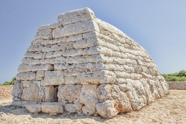 Naveta des Tudons ossuary at Menorca island, Spain. Stock photo © tuulijumala