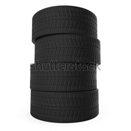 Stack of automobile tyres isolated on white background. Stock photo © tuulijumala
