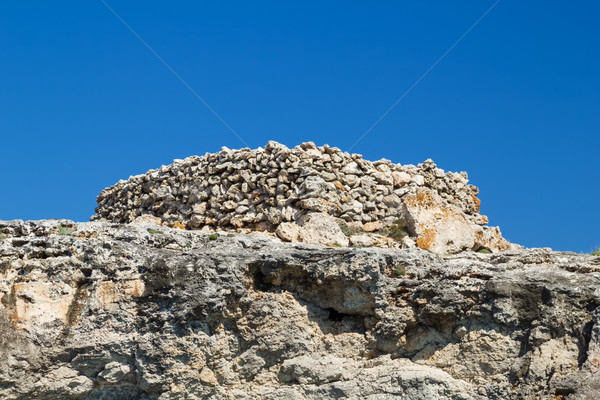 Ancient stone talayot at Menorca island, Spain. Stock photo © tuulijumala