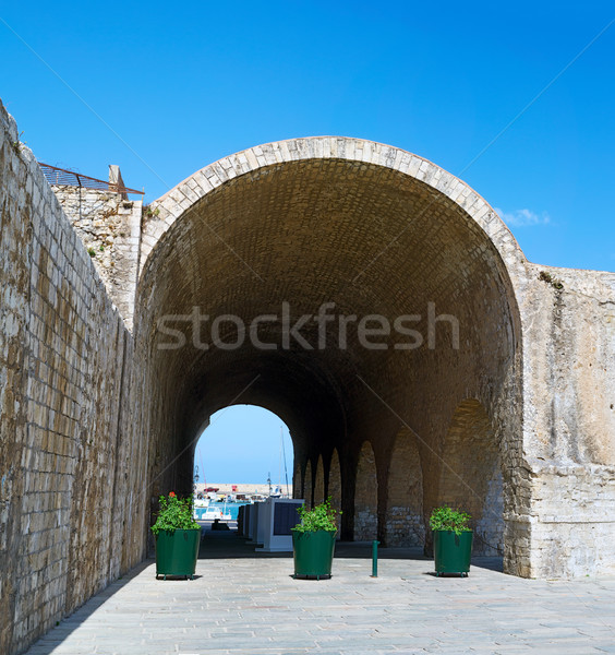 Ancient Venetian Arsenals stone arch in Heraklion, Crete. Stock photo © tuulijumala