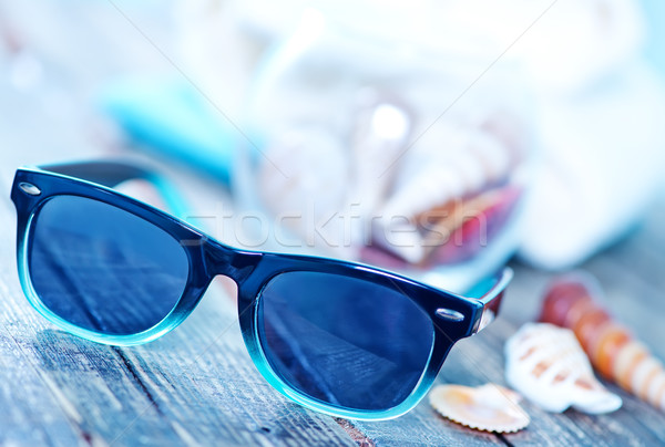 sun glasses and flip flops  Stock photo © tycoon