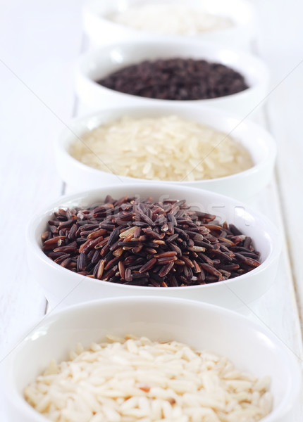 Different kind of raw rice, raw rice in the white bowls Stock photo © tycoon