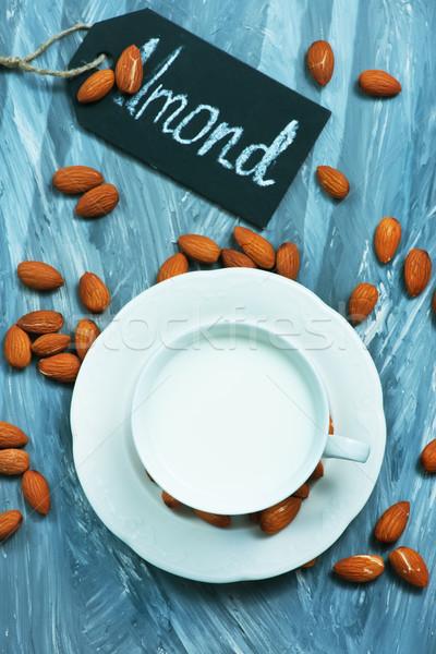 Mandula tej csésze asztal gyümölcs eszik Stock fotó © tycoon