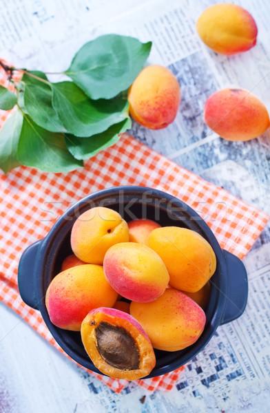 étel narancs asztal piros növény fehér Stock fotó © tycoon